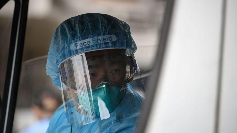 Coronavirus: à Hong Kong, le personnel hospitalier menace de faire grève